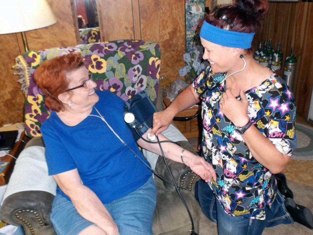 Home Health Nurse visiting patient