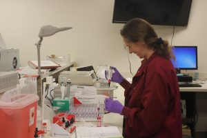 Lab Tech performing tests in house